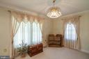 Living room with Swarovski crystal chandelier - 6302 PANDA CT, WALDORF