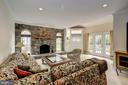 inviting first floor  family room with fireplace - 12 CLIMBING ROSE CT, ROCKVILLE