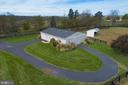 View of the barn with paved access and hay storage - 21960 OATLANDS RD, ALDIE