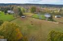 Aerial view of the house, barn and two run in shed - 21960 OATLANDS RD, ALDIE