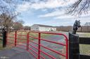 Gated entry to the barn - Fully fenced - 21960 OATLANDS RD, ALDIE