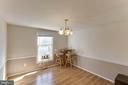 Dining room with chair rail and dual tone paint - 218 FALLSWAY LN, STAFFORD