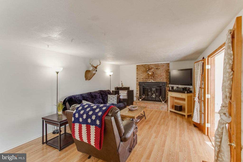 Family room with cozy wood burning fireplace - 218 FALLSWAY LN, STAFFORD