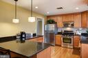 Remodeled kitchen with designer lighting - 2307 BARBOUR RD, FALLS CHURCH