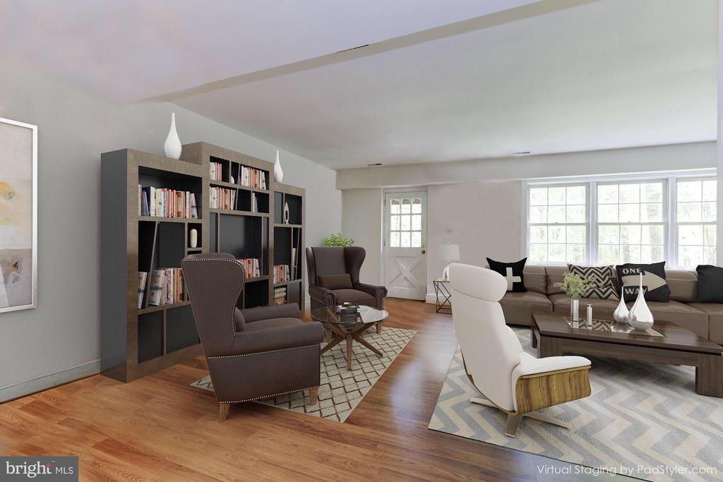 Virtually staged basement with different furniture - 10620 HUNTER STATION RD, VIENNA