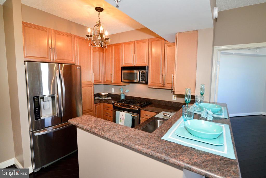 The kitchen as you enter the unit - 11760 SUNRISE VALLEY DR #1014, RESTON