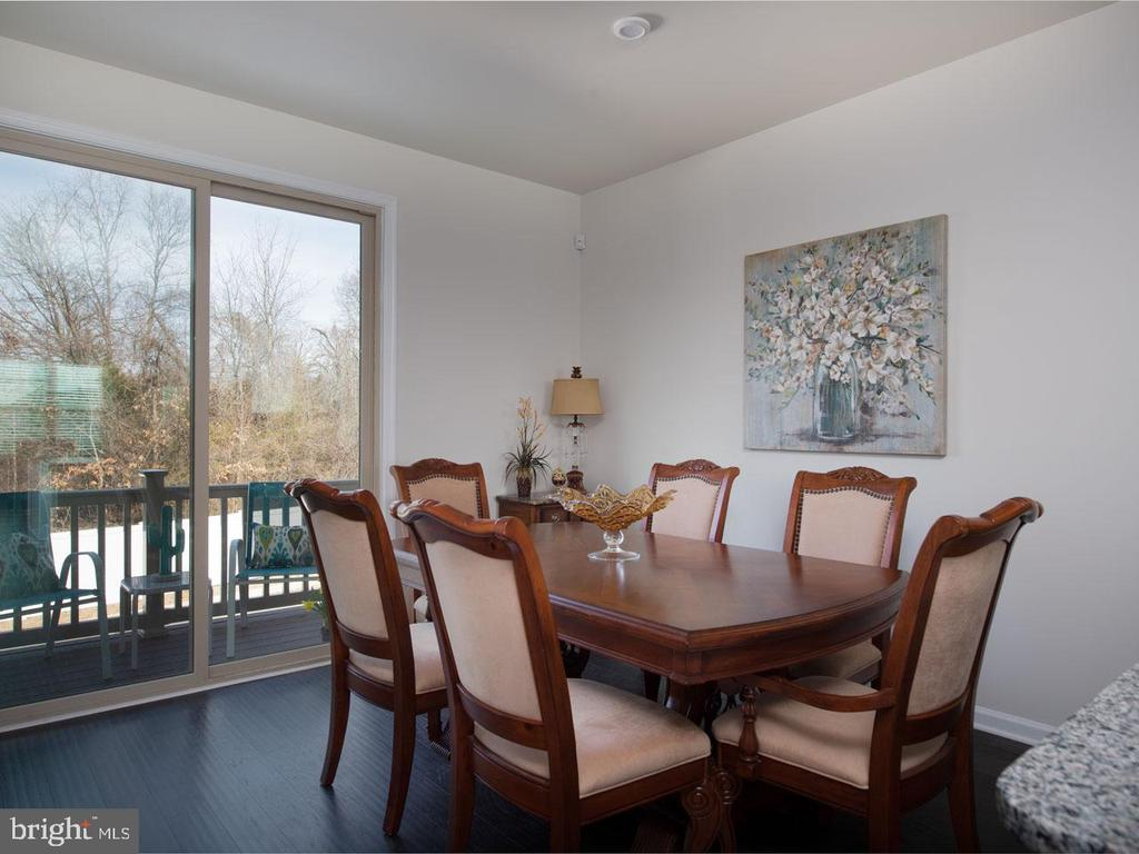 Dining room with access to deck - 43837 STUBBLE CORNER SQ, ASHBURN