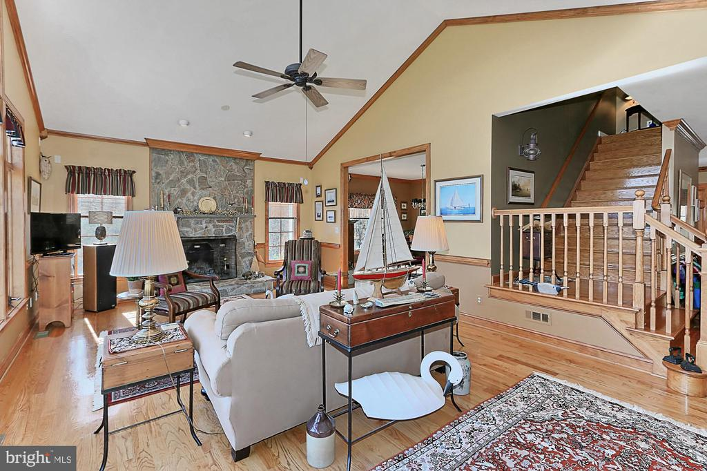 Inviting family room around a cozy stone fireplace - 94 CANTERBURY DR, STAFFORD
