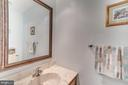 Main level half bath with ceramic tile floor - 1113 JOHN PAUL JONES DR, STAFFORD