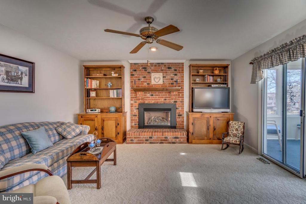 Family room with gas insert and brick fireplace - 1113 JOHN PAUL JONES DR, STAFFORD