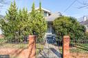 Exterior Front with large trees for privacy - 4115 10TH ST NE, WASHINGTON