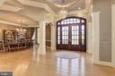 Grand Foyer opens to Formal Dining Room - 8544 LEISURE HILL DR, BALTIMORE