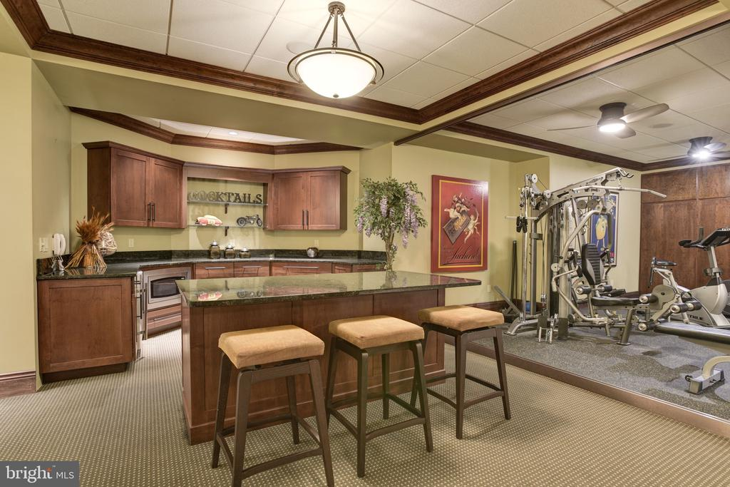 Lower Level Dry Bar open to Exercise Room - 8544 LEISURE HILL DR, BALTIMORE