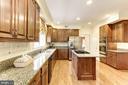 Tile backsplash and hardwood floors in the Kitchen - 1114 ROUND PEBBLE LN, RESTON