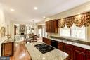 Kitchen view of Breakfast area and Family Room - 1114 ROUND PEBBLE LN, RESTON