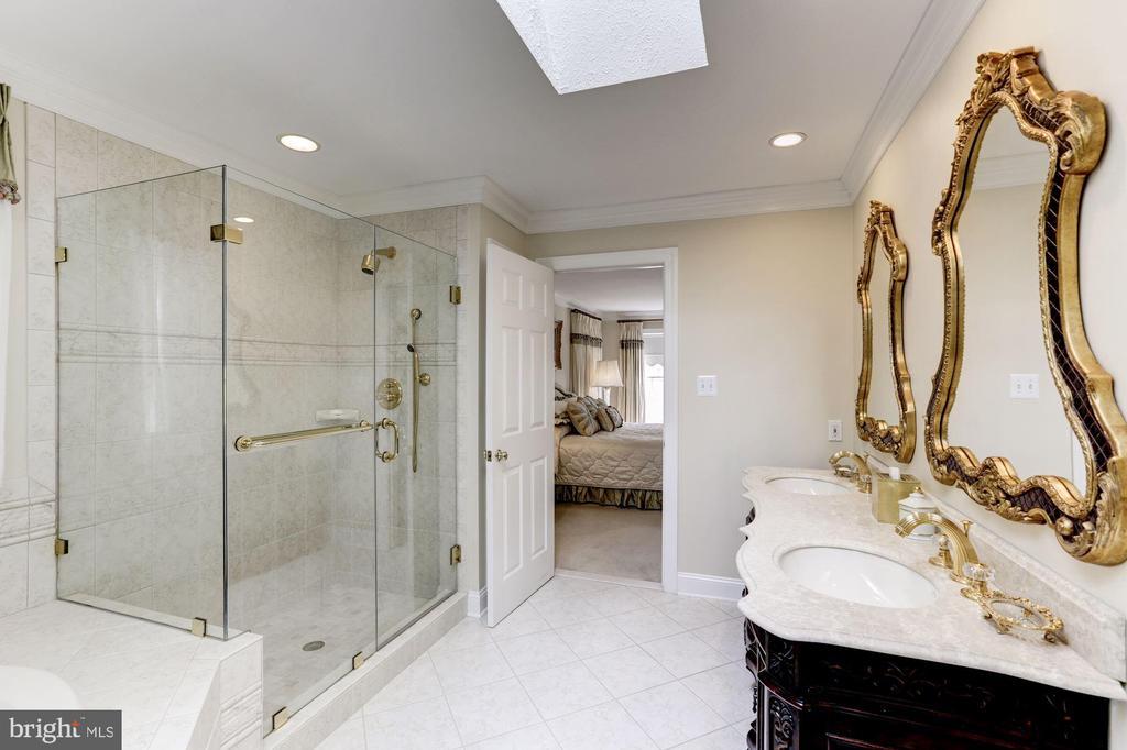 Granite and rimless glass shower surround in OBR - 1114 ROUND PEBBLE LN, RESTON
