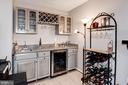 Gorgeous wet bar w/mini fridge and wine rack - 9802 PEPPERMILL PL, VIENNA