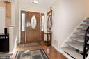 Custom front door w/sidelights and hardwood foyer - 9802 PEPPERMILL PL, VIENNA