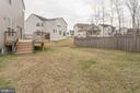 Right side yard view back to deck - 10283 SPRING IRIS DR, BRISTOW