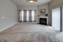 Slider to deck adjoins fireplace in family room - 10283 SPRING IRIS DR, BRISTOW