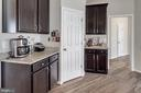 Butlers pantries flank walk-in kitchen pantry - 10283 SPRING IRIS DR, BRISTOW