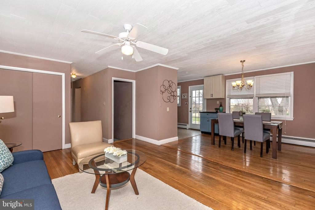 Open floor plan living room and dining room - 3311 CHURCH RD, BOWIE