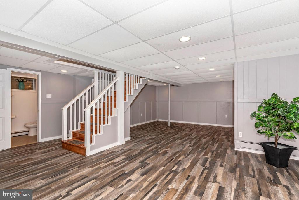 Finished basement with new flooring and paint - 3311 CHURCH RD, BOWIE