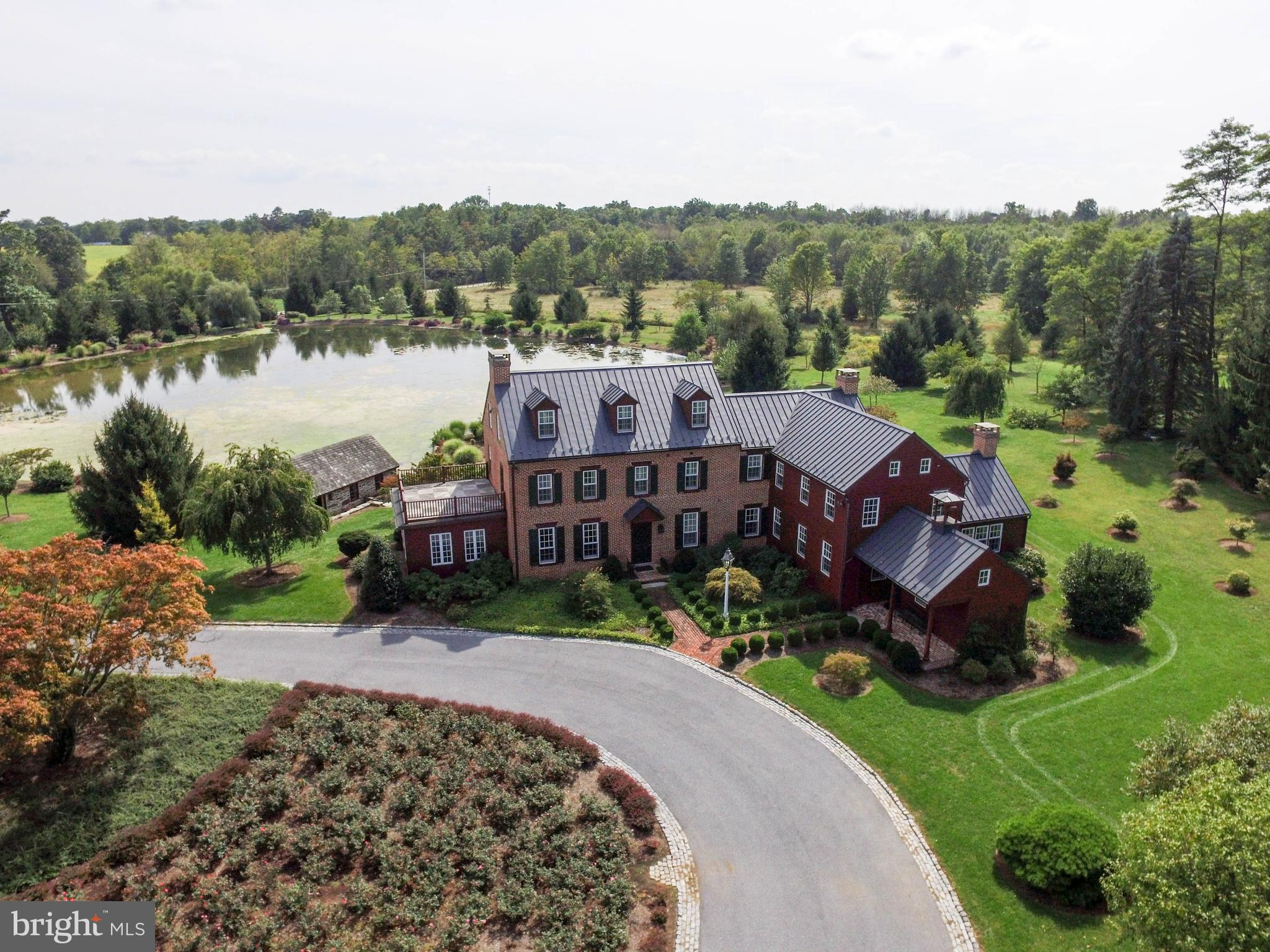 Aerial View of Home & Pond
