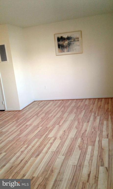 Laminate flooring in very large living room - 62 BRISTOL CT, STAFFORD