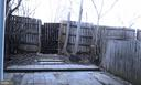 Privacy fenced back yard with extensive patio - 62 BRISTOL CT, STAFFORD