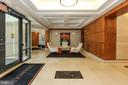 Secure lobby with concierge desk - 1830 FOUNTAIN DR #1001, RESTON