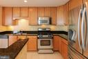 Gas range and newer refrigerator - 1830 FOUNTAIN DR #1001, RESTON
