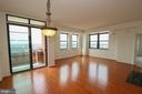Combined Living and dining room with balcony acces - 1830 FOUNTAIN DR #1001, RESTON