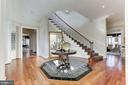 Foyer with curved staircase - 7826 SWINKS MILL CT, MCLEAN