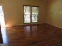LIVING ROOM WITH HARDWOOD FLOORS - 6534 PARISH GLEBE LN, ALEXANDRIA