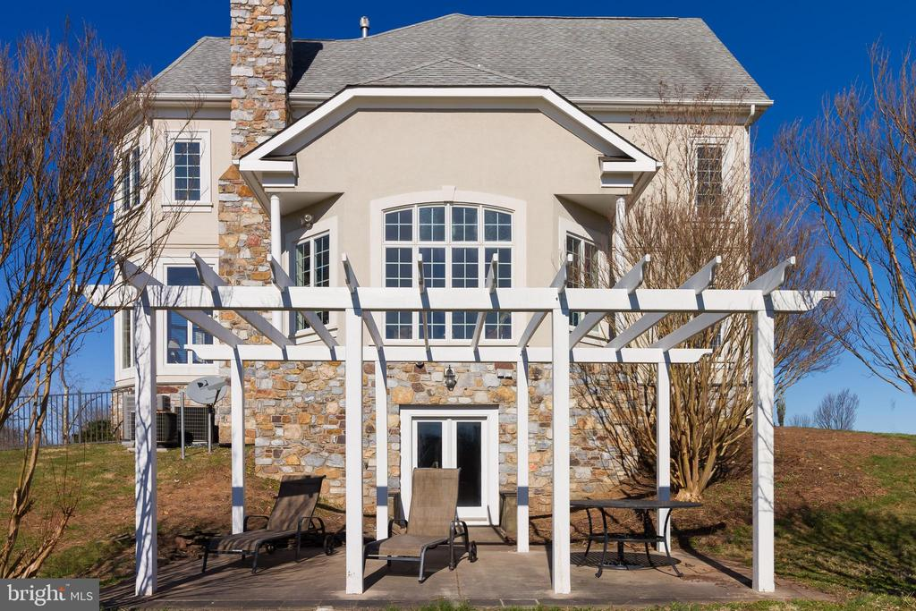 Side of home has a gorgeous pergola and walks out - 17160 SPRING CREEK LN, LEESBURG