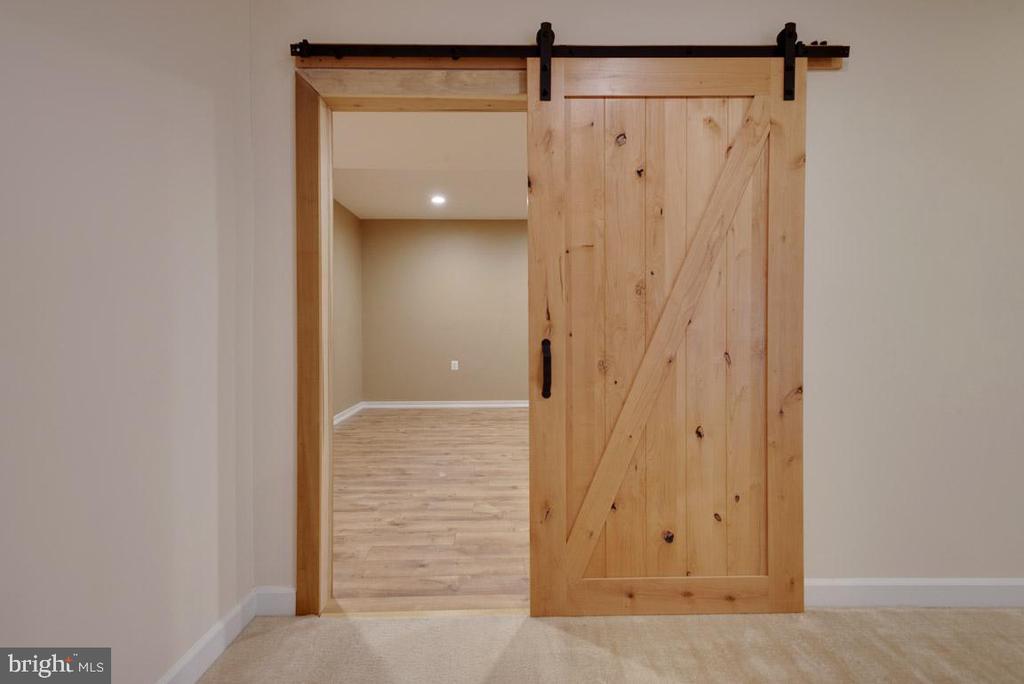Barn door into Media Room - 25532 EMERSON OAKS DR, ALDIE
