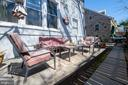 Rear yard/patio - 4348 ELLICOTT ST NW, WASHINGTON