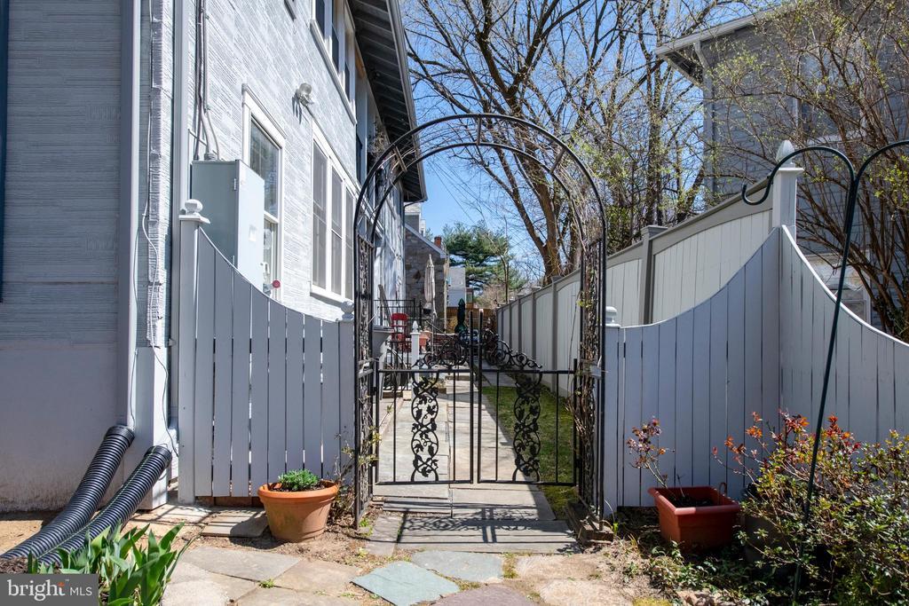 Gate to rear yard - 4348 ELLICOTT ST NW, WASHINGTON