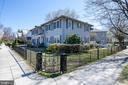 Side yard with iron rod fence - 4348 ELLICOTT ST NW, WASHINGTON