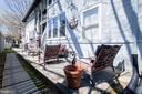 Rear of building/patio - 4348 ELLICOTT ST NW, WASHINGTON
