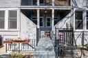 Rear of building/fire escapes - 4348 ELLICOTT ST NW, WASHINGTON
