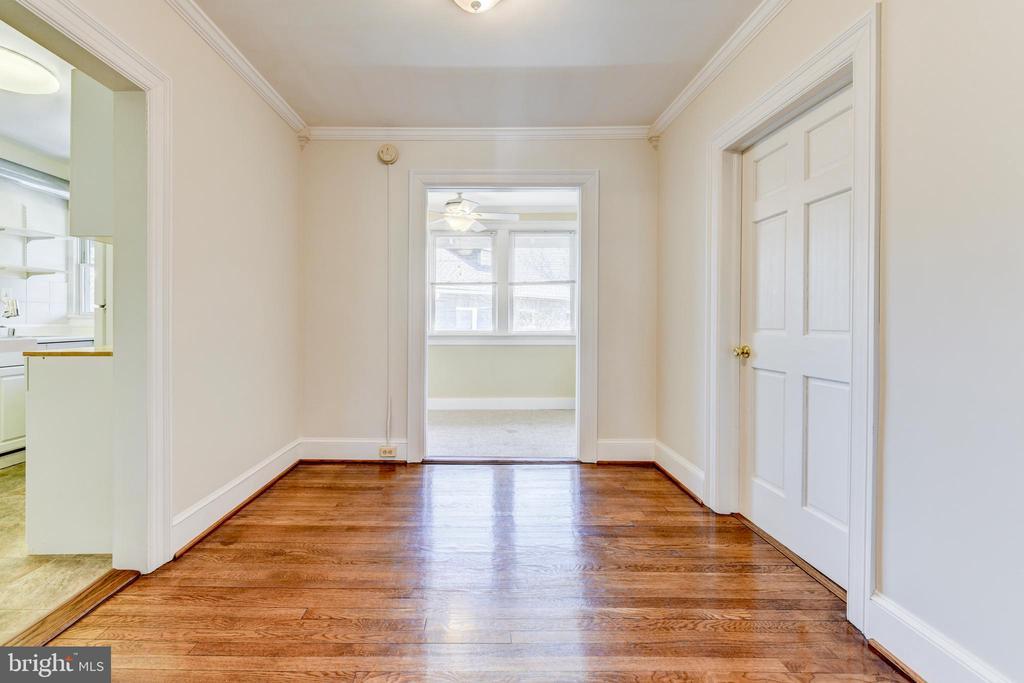 Unit #3: dining room leading into sunroom - 4348 ELLICOTT ST NW, WASHINGTON