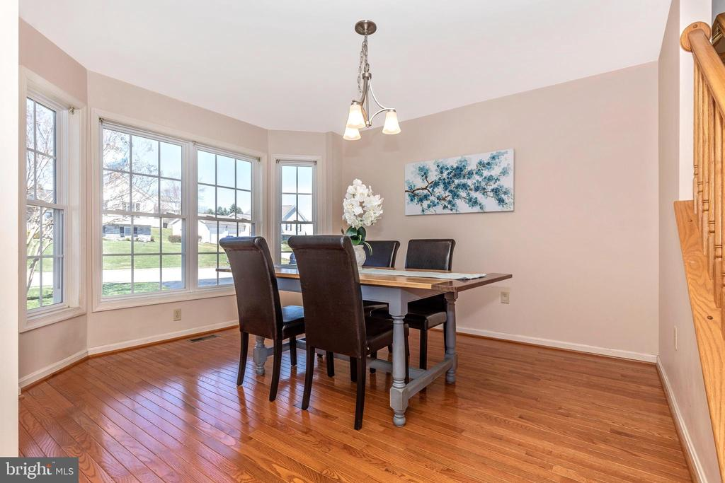 Dining room with huge bow window - 115 BOSC CT, THURMONT