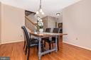 Dining room with hardwood floors - 115 BOSC CT, THURMONT