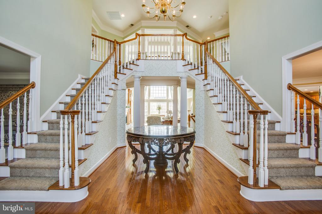 Grand foyer w/ 2 story ceiling & double staircase - 5916 DEEP CREEK DR, FREDERICKSBURG