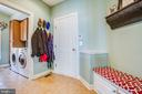 Separate laundry room from mud room w/ pocket door - 5916 DEEP CREEK DR, FREDERICKSBURG