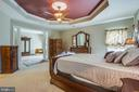 Classic columns separate bedroom from sitting room - 5916 DEEP CREEK DR, FREDERICKSBURG