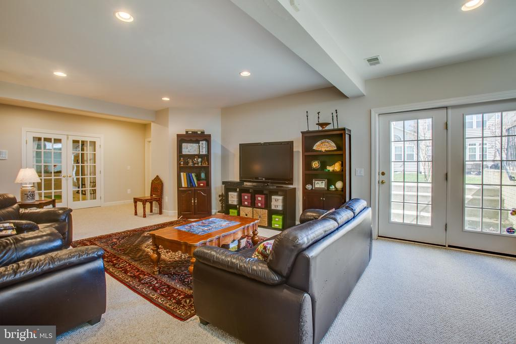 Lower level family room w/ walk-out stairs - 5916 DEEP CREEK DR, FREDERICKSBURG