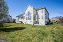 Lot gently slopes away from house - 5916 DEEP CREEK DR, FREDERICKSBURG
